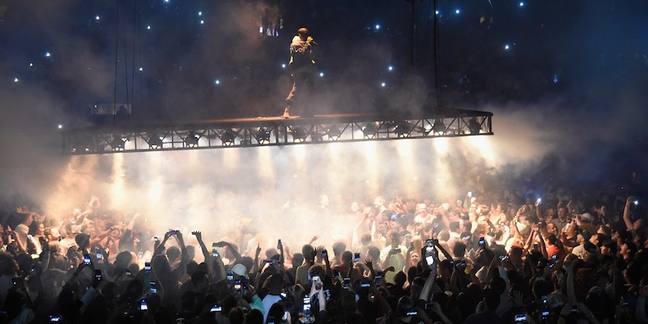 Fan Attempts to Climb Kanye's Flying Stage in Atlanta